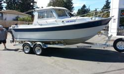 THIS AD HAS BEEN REVISED! This boat is made for big water with a deep V Hull. Comes with: Upgraded 2008 Merc V-6 motor. Professionally installed New outboard bracket New swim grid Cooler on the grid all fenders and tie up ropes Anchor system Tandem roller