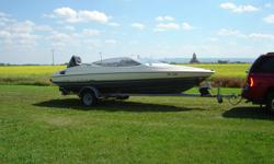 1990 20 ft. Bayliner Capri Bowrider (open bow), 2007 Mercury 150 hp motor EFI, power tilt & trim, new prop, new wiring, gauges & controls. Comes with ski pole, high grade custom tarp, factory convertible top and full mooring cover, galvanized factory bunk