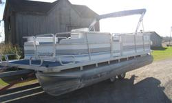 "1993 SunCruiser 20' Pontoon Boat w/40hp Johnson * Full Furniture Seats 10 * 20' Long x 8' wide * 24"" Diameter Pontoons * 40 hp Johnson 1993 * 2 Stroke Oil Injected * Power Tilt/Trim * Runs great * Storage Area under the seats * Rear Tanning Bed * Helm"