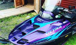 TRADE FOR BOAT! 1997 Polaris Ultra Touring 700, smokes a little on first start but runs strong. Little rusty here and there but anything from the 90's does! Great sled for the upcoming winter, has cover & jackstand.
