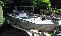 17' aluminum bass boat' Side Console, gauges, Hummingbird depth/fish finder 1992 40 hp Evinrude WITH Power Trim/tilt, 135/140 cylinder compression 2004 Shorelander trailer with swing away tonque Trolling Motor with new deep cycle battery Livewell New