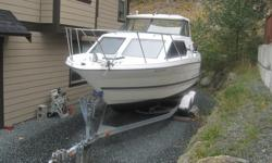 1998 Bayliner 2452 Ciera. This 24.5 foot boat has 5.0 L Mercruiser and has a 8.5 foot beam. This boat is a great fishing/weekend cruiser and sleeps 4 comfortably. Has shore power with battery charger, AC/ alcohol stove, fridge, microwave, sink with hot