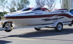 Sea-doo challenger 1800   Twin 110 hp rotax engines, approximately 350 hrs of run time. Seats 7 Does 45mph, can tow a tube easily (towed 4 teenagers with ease) Can run in 24 inches of water, Trailer, swim ladder, bimini top, safety equipment, 4