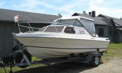 19 1/2 ft. Beachcraft boat with cuddy Completely rebuilt 485 Merc inboard motor (Have all receipts) Approx. 10 hours on new motor Comes with aluminum trailer Also comes with fully enclosed back canopy in excellent condition (not shown)