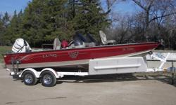 2000 Lund Pro V Magnum 2025   2000 Evinrude E200F 2000 Evinrude F15 2000 EZ Loader Tandem Trailer w/ Chrome Wheels   Features Include:  Stone Guard, load guides, front and rear trolling motors, 2 fish finders, GPS, 2 live wells, 2 bait wells, air ride