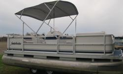 "2000 Sweetwater Challenger 18' Pontoon Boat w/25 hp 2000 Mercury 4 Stroke Bigfoot * Full Furniture Seats 10 * 18' Long x 8' wide * 24"" Diameter Pontoons * 25 hp Mercury 2000 * 4 Stroke Bigfoot * Power Tilt/Trim * Runs great * Storage Area under the seats"