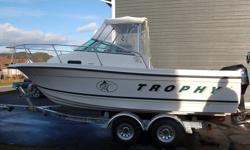 2002 Trophy 2002 WA Boat includes Bimini top with full enclosure, Full winter cover, Porta-pottie, Rod holders, Rod Racks, Livewell, Rear jump seats, Table in cabin, Bow pulpit with Anchor Roller , Anchor locker, Dual Batteries with switch, Trim Tabs,
