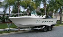 2000 TROPHY CENTER CONSOLE BOAT. This boat is in excellent condition , powered by 125 hp mercruiser saltwater outboard.The boat has always been inside stored on the trailer and has no fading of the gelcoast. Lots of storage space ,live wells ,rear seats,