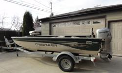 Always stored inside during winter months. It includes the following: welded aluminum hull; live well and bait well; built-in fuel tank; 4 storage compartments as well as a lockable fishing rod compartment; 4 removable swivel seats; side gauge panel;