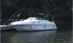 2001 Searay 260 Sundancer Description: This one owner cruiser Air conditioning, This one owner roomy cruiser features all the comforts of home. It is well equipped with following features. The cabin features an aft sleeping area and the bow table can also
