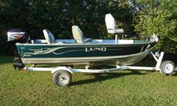 2002 Lund Rebel 1440-v boat with a 30hp Merc 4 stroke for sale. Boat is in excellent condition. It comes with a front mount 50lb thrust Minnkota trolling motor, livewell, bilge and aeration pumps, navigation light posts, Humminbird fishfinder, shoreland'r