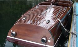 This is not your ordinary fiberglass 21 ft lake boat. (never in salt water) This is a 1 of 1 built from the finest Mahogany wood based on an early 1940's Chris Craft wooden speed boat. Custom Built by St. Clair Boatworks Inc. in Carmel, Indiana. This boat