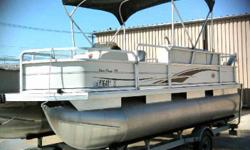 Fall Sale! One owner 18 ft. pontoon with 50 hp mercury outboard. This pontoon is Tracker's signature series with 3 fishing seats, 2 seats in the front with live well plus 1 seat in the rear. Three boarding doors with boarding ladder at rear door. There is