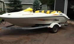 Seadoo Sportster LE 951 DI jet boat 130HP , 15 foot ,Brand new engine with 4 hours on it (one year warranty on engine) new marine battery , new sound system , trailer and boat just like new . Works great