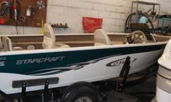 2005 Starcraft 166 side console,powered by a 50HP mercury,oil injected w/power trim,minkota electric bow motor,low hours,live well,stereo,rod holder compartment,half swim platform,full cover,includes factory trailer,serviced,always garaged,ONE OWNER,can