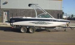 21' Of Versatility! 325 HP Indmar V-Drive Engine, Seats 13, Tower, Bimini Top, Stereo, Open Bow, Perfect Pass Speed Control, Depth Finder, Wakeplate, Pop-Up Cleats, Ski Pylon, Ballast System, Cover and BoatMate Tandem Axle Trailer with Surge Brakes, Disk