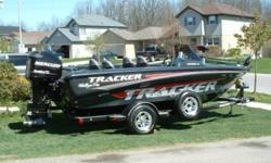 "2007 Tracker ""FISHING TEAM EDITION"" , 115 HSP Mercury Optimax XLwith stainles steel prop and warranty until 2014, 8 lockable compartments, push button start with start code, lockable rod locker, 2 Lowrance units both with GPS and card readers for hot"