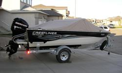 c/w 2010 Mercury 115HP Optimax 2 stroke outboard and EZ Load trailer. In floor storage, rod holders, carpeted floors and 4 chairs. Rear fold down bench and front cushioned seating. Weather canopy and storage tarp. 2 live wells and 50 lb. Minn Kota
