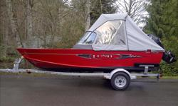 This 1625 red Fury XL Sport is one of the strongest selling Lund Fishing Boats. The boat is in excellent condition with less than 20 hours use. It is very well equipped and powered by a 2013 Mercury50 ELPT 4 Stroke tilt/trim motor. The following features