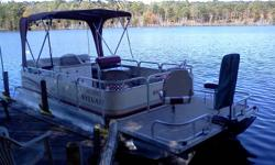 20 ft. Seats 10 40hp. Evenrude with tilt and trim. Am FM sterio live well and fishfinder. Looks and runs great.