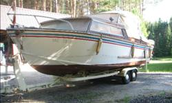 21' Delainy Boat Works wood boat built in Barrie ON, sleeps 4, head, trailer included, also 9.9 merc trolling motor, and 90 Johnson outboard. Stored indoors. $1500 Please call Watson after 6 pm