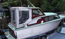 23 ft 1956 chris craft boat on trailer. low hr. 351 ford windsor velvet drive inboard . good shaft,prop etc.  new top canvas .was surveyed        epoxy and fiberglass covered cedar hull in good shape. trailer included .lift rack wiyh 8 ft unsinkable punt,