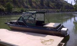25ft Jet Boat with Cuddy, this boat has it all!!!! I designed it myself and had it built By Rivershore Boat Company here in kamloops BC...it fetures a 350 hp  motor with a hamilton Jet.  250 L fuel tank.. Large sleeping cuddy.... Great for familys with