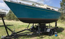1979 Mirage 26 foot sail boat. Family Cruiser with Head and Galley. Sleeps 5. Good Sail Inventory, Good Equipment Inventory. Tandem Axle Trailer with 4 new tires included Electric start 9.9 HP Yamaha Engine Well over $20,000.00 of value. Reduced from