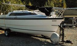 Ready to sail with 5 sails incl. 150 % self furling headsail, 2 winches, winch assist for mast and anchor raising, 3 anchors, radar reflector, swim ladder, 20 hp Mercury motor 0hrs with new motor control, new steering cable for twin rudders and motor, 3-