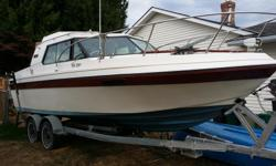 26ft renielle cuddy cabin includes stove toilet mercury alpha 1 outboard 5.7 l aux mercury outboard 4 stroke 15 hp tandem. trailer with electric winch Runs great