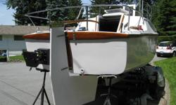 27ft Sail boat with its own customized trailor, completley restored from bow to stern, inside and out, new paint 2010 , all new wiring and lighting, teak and mohogany throught out, new windows new customized safty railings , lots of stainless steel and