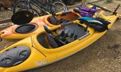 2 kayaks with paddles , skirts, life vests, safety kits and J hooks(for car racks)