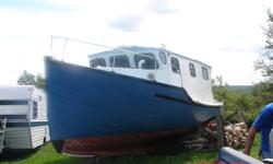30 Foot Cape Islander Boat wood needs work for more info call..574-6141
