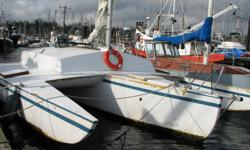 This Kismet trimaran is 32 ft long and 20 ft beam. She is a very fast and stable sailboat with hydraulic wheel steering, aluminum spar with stainless steel rigging, and raising/lowering outboard bracket. The hull and amas are in great shape and do not