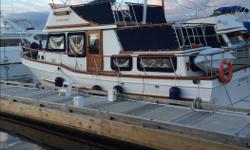 """36' Grand Mariner Tri Cabin Trawler with 13'2"""" beam powered by a 120HP Perkins six cylinder diesel, approx 3000hrs. Bow thruster, Windlass with 280' of 5/16 chain connected to a Bruce Anchor, Dual Helm Stations and full set of window/door Covers. Survey"""