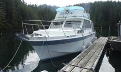 twin 440's,actually fairly economical,12' beam,command bridge,sleeps 6,gally,bathroom,3000 Honda generator,completly set up for chartering,fishing,diving ect... also a 80 foot dock and anchoring,half hour outside Tofino,37,000 will consider trades,boat