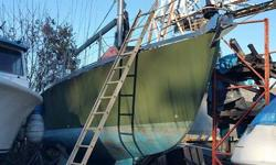 This site won't allow me to post more than 2300 characters so call for more info. The short version Hull was built in 1998 by folkes, previous owner completed, including epoxy the inside of the hull before spray foam. The mast and boom were built and