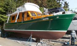 "If you are looking for a perfect cruising vessel, and/or live-aboard that is fairly priced then come and take a look at this 1981 North Passage cruiser, ""The Glass Slipper"". Two state-rooms, one head (bathroom) with tub and shower, all teak interior."