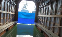 Boat House in North Saanich Marina. Reduce your maintenance costs, keep your vessel clean and shiny even in the worst of weather. No winter growth....ever! This is a huge opportunity to purchase a very nice Boat House with curtain at a fraction of the