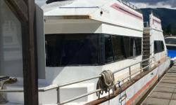 Moored at cowichan lake marina Aluminum hull,merc cruiser 120 hp Aft stateroom,bunk room and upper berth Two bathrooms Needs work Open to offers