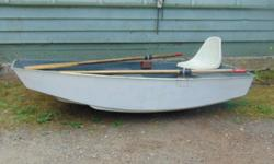 8 Ft Fiberglass Boat with oars and a seat
