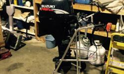 Long shaft 4stroke Suzuki 9.9, remote control modle. Manual tilt, Manual start. Has chargeing system and can add optional electric start.. Great compression, runs excellent. Shifts and pisses water asking 1100 obo can also provide installation has minor