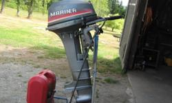 9.9 Mariner outboard motor Long leg Comes with gas tank and hose Runs good