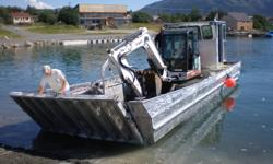 approx 32' by 11' aluminum barge with a day cab, a 225 merc engine, gps sounder, VHF radio and a 2009 galvanized triaxle trailer