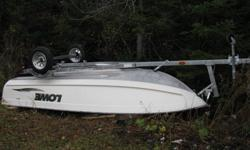 14 ft 6 in Lowe aluminum boat Only used a few times. Wide and Deep.Takes long shaft motor.Comes with brand new 2011 1000 pound capacity Yatch Club galvanixed.Trailer only used to bring boat home.......15 HP 4-stroke Long shaft Honda  Outboard available