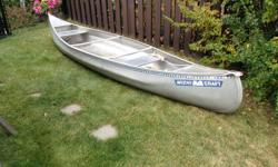 MICHICRAFT 15 Foot Aluminum Canoe. Strong, Stable and Light (70 lbs.). Very Good Condition.