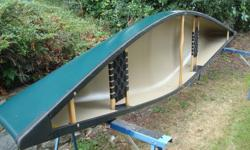 This Wenonah canoe made of tough lightweight Royalex material has been in the water twice. It is like new.