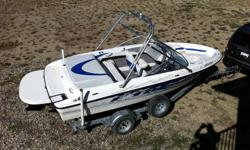 18.5 foot long, 4.3 Mercruiser, has wake tower, swim platform, hour meter, spare prop, bimini top, snap on cover, custom travel tarp, boat trailer. Only 20 hours, just serviced. Mint condition.