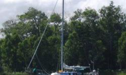 Beautiful 1984 Bayfield 32C Cutter rigged cruising sailboat and 38' LWL triple axle highway trailer.  This boat has been to the Bahamas and back and is capable of cruising anywhere you want to go.  Sleeps 5.  Yanmar diesel engine.  Main, Genoa, Stay Sail,