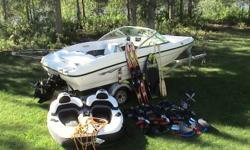 Includes everything you see in the picture, ski's, kneeboard, tube, rope, life jackets, trailer and more. 4 cyl. Merc Cruiser with Alpha 1 leg, power trim, open bow, stereo with Sirius radio, swim ladder, and fish/depth finder. 13000.00 obo